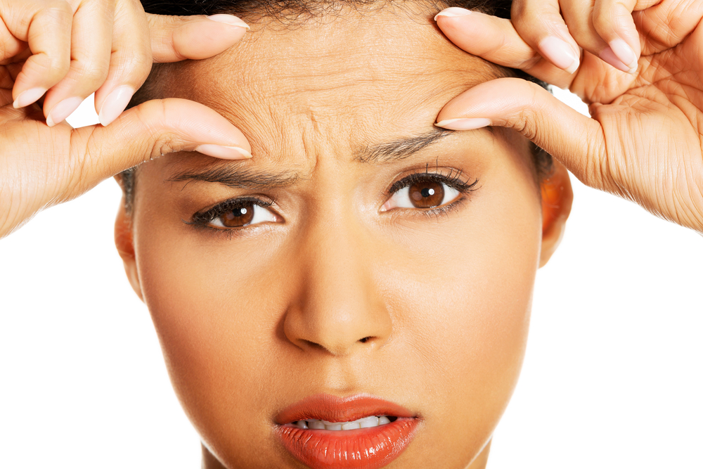 Woman worried about forhead wrinkles