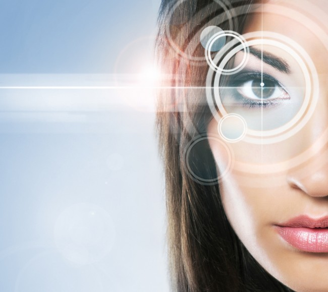 Close-up portrait of a woman with a virtual hologram on her eyes (future of skin care concept).