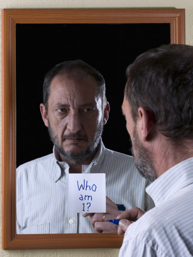 Mirror reflection of a man suffering from Alzheimer's disease