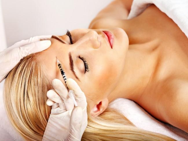 Woman getting a Botox treatment.