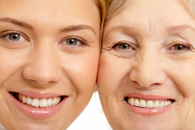 Closeup of the faces of a mother and daughter to highlight skin aging.