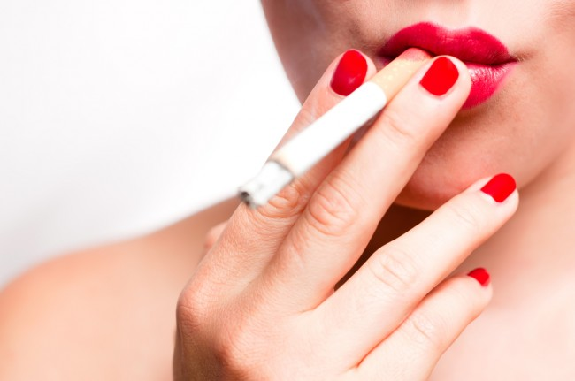 Closeup of a woman smoking a cigarette.