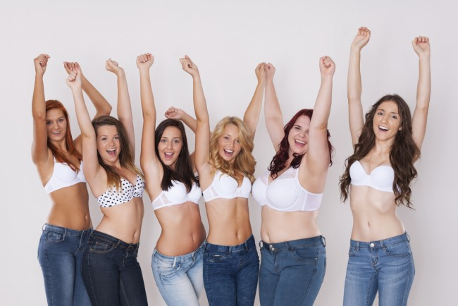 Group of women wearing jeans.