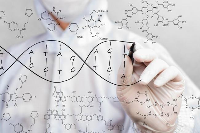Scientist writing molecular structure of DNA