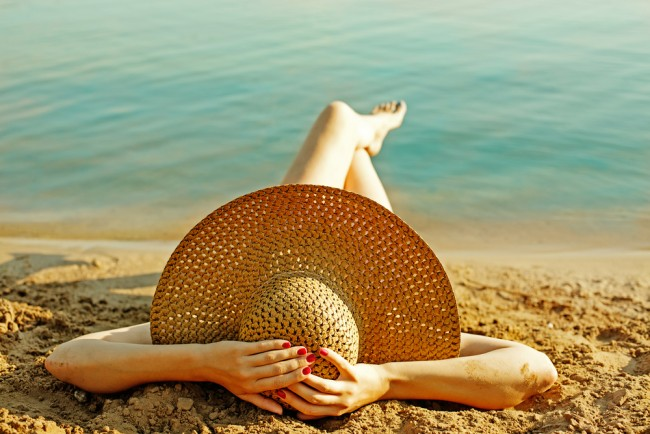 Woman wearing a hat sunbathing