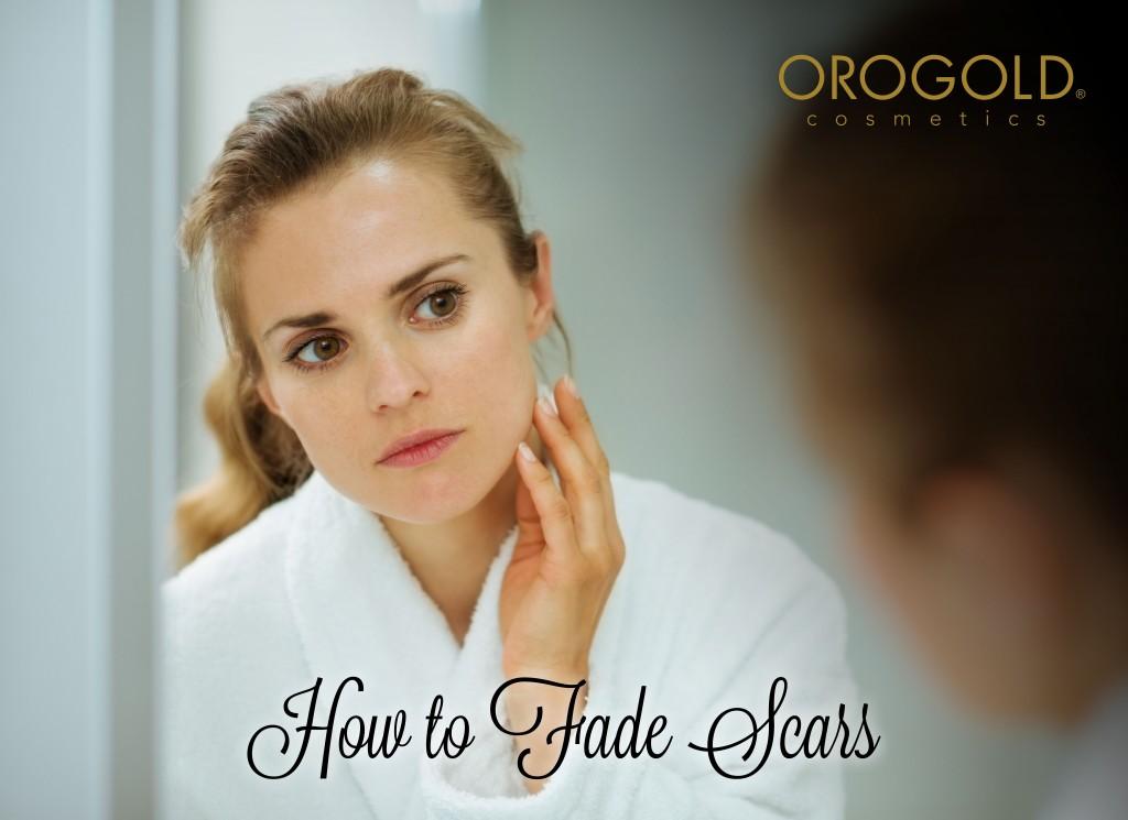 Woman examining acne