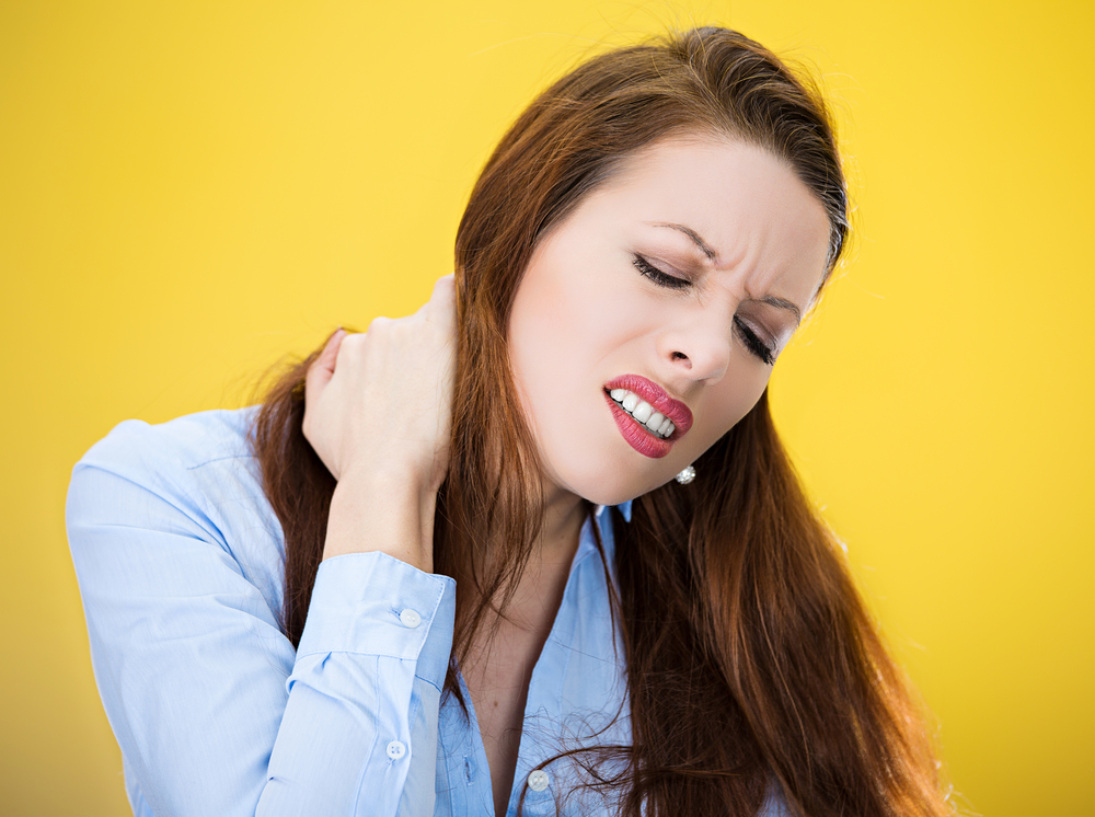 Woman with a neck ache.