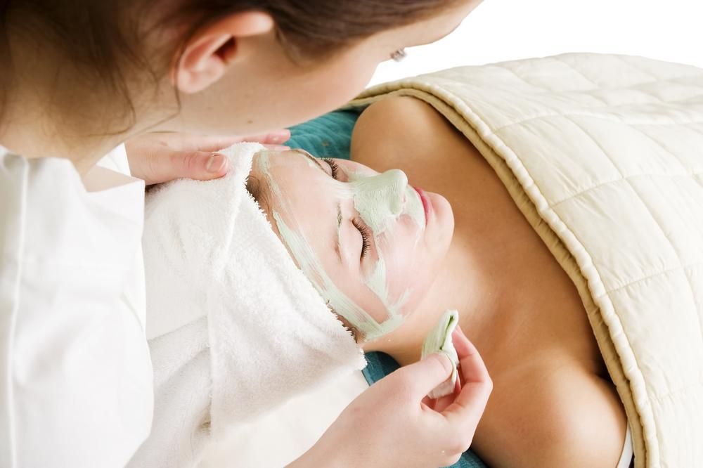 Woman getting a facial treatment.