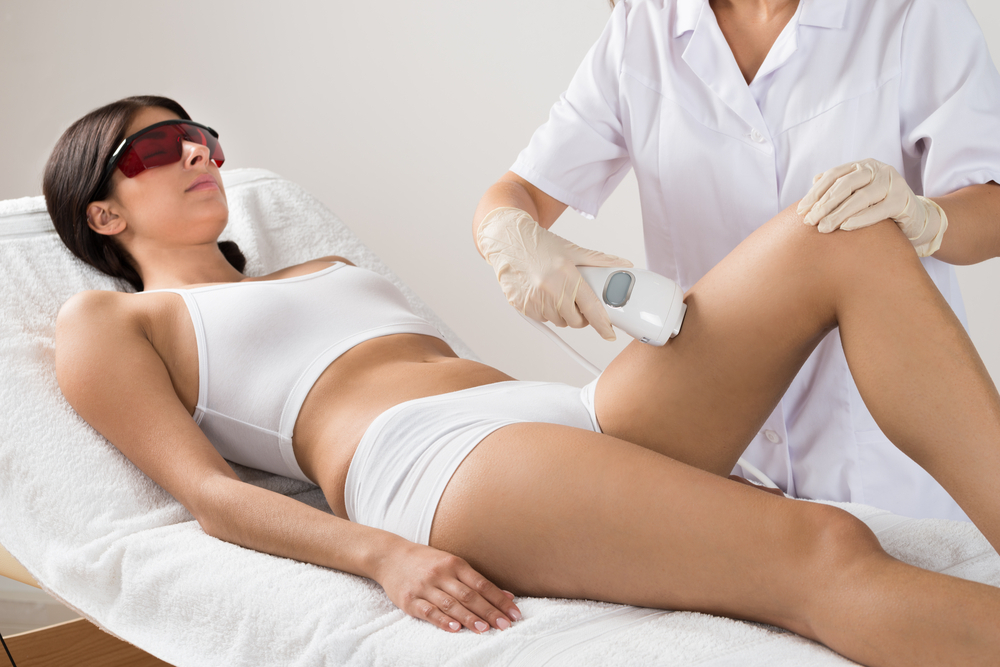 Woman getting hair removal treatment