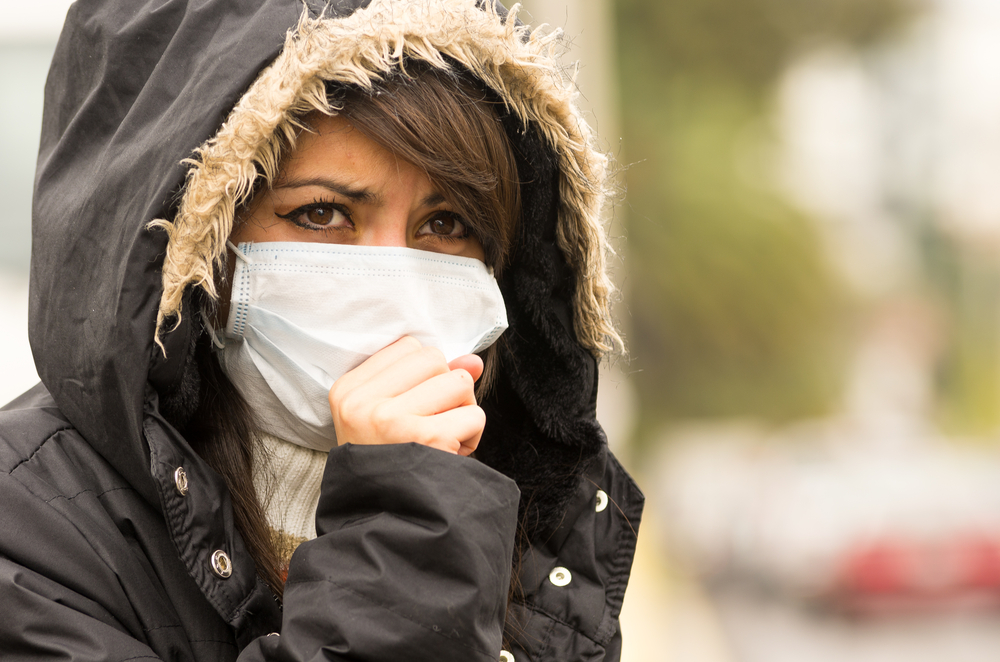 Woman wearing a pollution mask