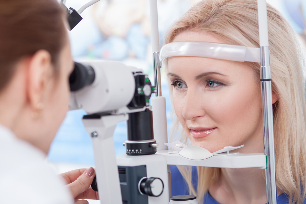 Woman getting eye examined