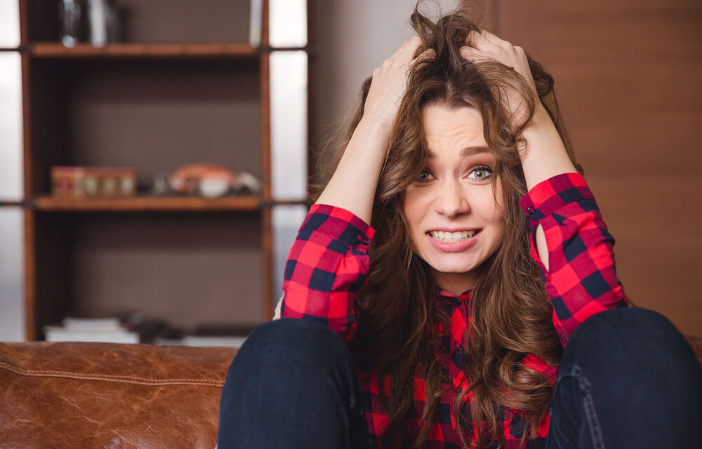 Stressed woman holding her hair