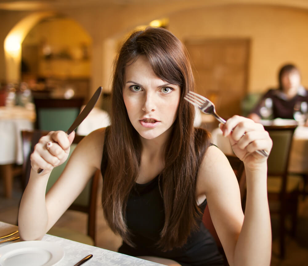 hungry woman with empty plate