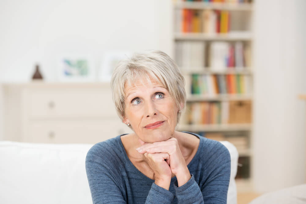 Mature woman looking wistful and reminiscing