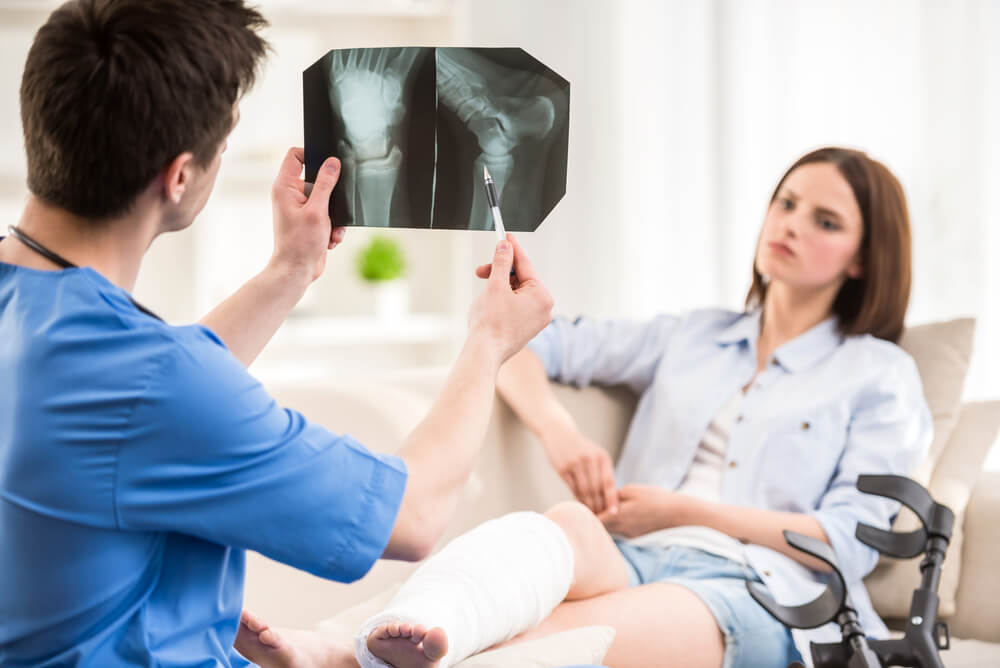 Physiatrist telling his patient about her bone condition