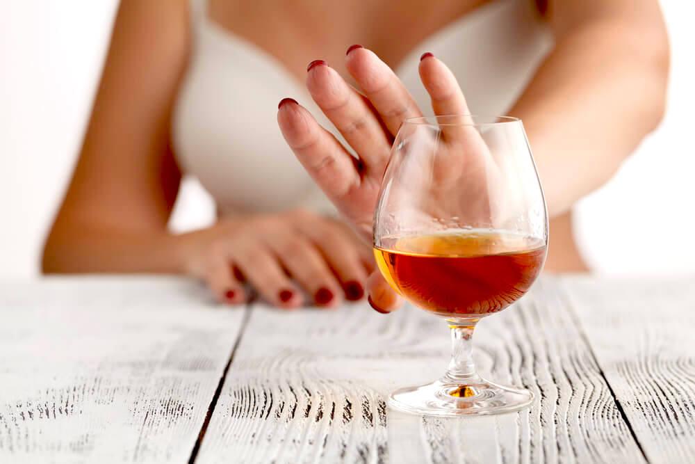 woman refusing alcohol