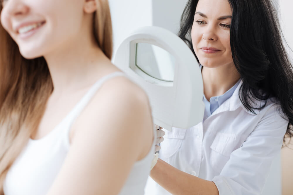 woman getting a skin check at the dermatologist's