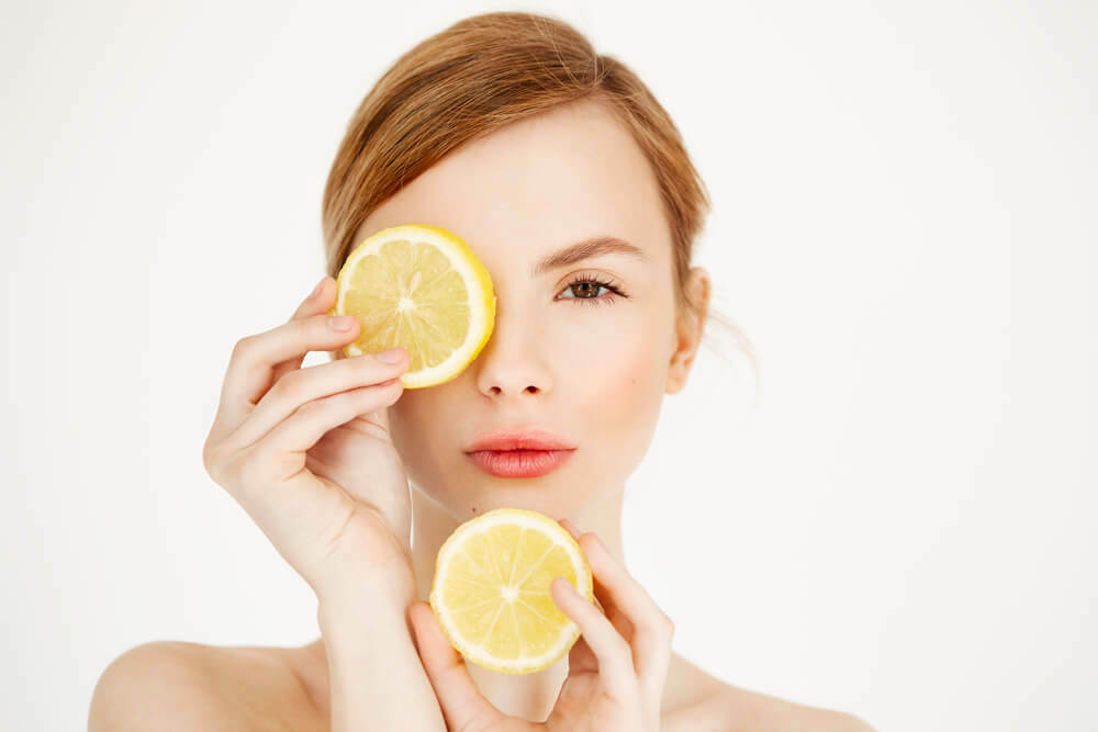 woman with citrus slices