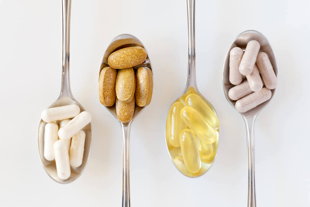 Assorted vitamin supplements on spoons