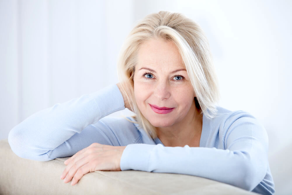 Mature beautiful woman resting and smiling
